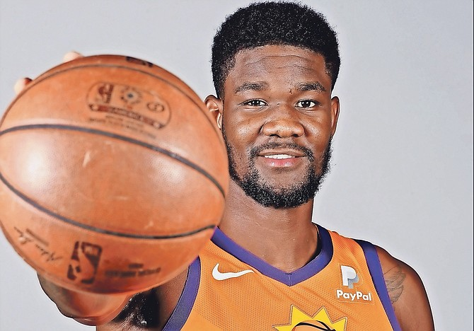 Phoenix Suns' DeAndre Ayton poses for photographs during media day at the NBA basketball team's practice facility on September 30 in Phoenix. Ayton will complete his 25-game suspension following the Suns' December 16 contest against the Portland Trail Blazers and is eligible to return December 17 on the road against the Los Angeles Clippers.  (AP Photos/Matt York)