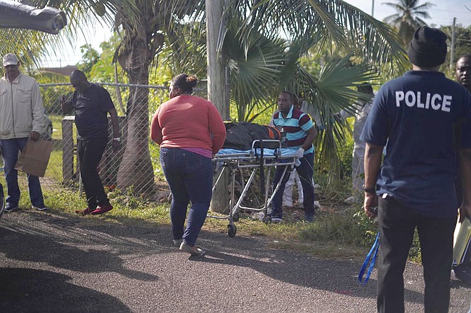 The body is removed from the scene in the Nassau Village area. Photo: Terrel W Carey Sr/Tribune staff