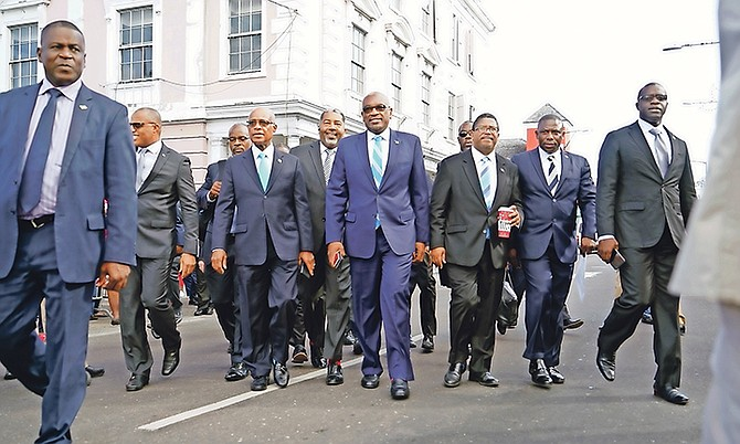 The FNM, led by Hubert Minnis, centre, heading towards the House of Assembly last week