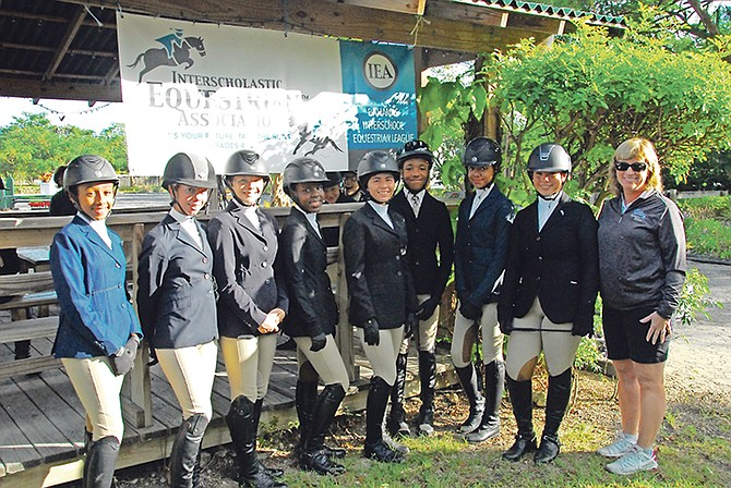 Eight riders participated in the Selection Trials to represent Team Bahamas in the first ever IEA International Invitational. Shown (l-r) are Hannah D'Aguilar, Peyton Wong, Elle O'Brien, Alexis Neymour, Taylor Haines, Nicholas Astwood, Mila Sands and Maya Tilberg with Roxane Durant, president and co-founder of the US-based Interscholastic Equestrian Association (IEA).
