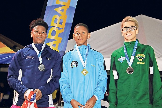 AT the 34th CARIFTA Aquatics Championships, Team Bahamas' Marvin Johnson (centre) led the way with 10 individual gold medals and 14 overall to win the High Point trophy in the 11-12 boys' category. Johnson won gold in the 50m, 100m, 200m and 400m Free; the 50m, 100m and 200m Back, the 50m and 100m Fly, and the 200m IM. As a member of relay teams he also won gold in the 4x50m and 4x100m freestyle events, 4x100m IM medley and the 4x100m Mixed Free.