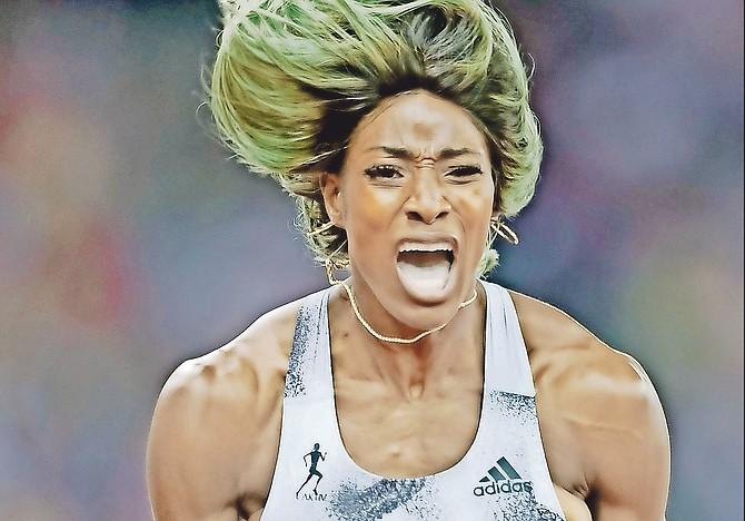 Shaunae Miller-Uibo, of the Bahamas, reacts after winning the women's 200m race at the Weltklasse IAAF Diamond League international athletics meeting in the stadium Letzigrund in Zurich, Switzerland, on Thursday, August 29, 2019.  (Ennio Leanza/Keystone via AP)