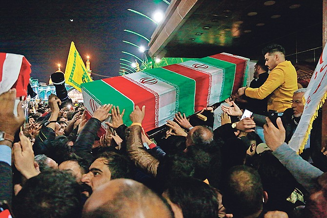 Mourners carry the coffin of Iran's top general Qassem Soleimani during his funeral in Karbala, Iraq, Saturday. (AP Photo/Khalid Mohammed)