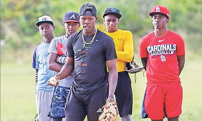 MIAMI Marlins prospect Jazz Chisholm gives some pointers to young, aspiring baseball players during a clinic in conjunction with International Elite-Sports Academy at the Pinewood Gardens baseball field. Photo: 10th Year Seniors
