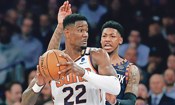 New York Knicks guard Elfrid Payton, right, defends as Phoenix Suns centre Deandre Ayton (22) looks to pass during the first quarter in New York. Ayton and the Suns routed the Knicks 121-98. He scored 26 points, grabbed a career high 21 rebounds and dished out two assists. He also had two blocks. (AP Photo/Kathy Willens)