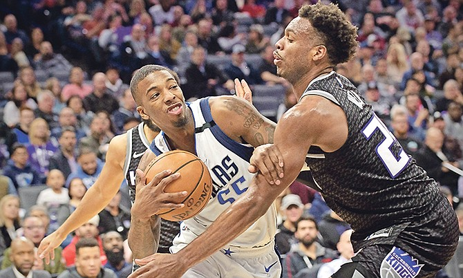 Mavericks guard Delon Wright (55) drives to the basket past Kings guard Buddy Hield (24) during the first quarter on Wednesday night.  (AP Photo/Randall Benton)