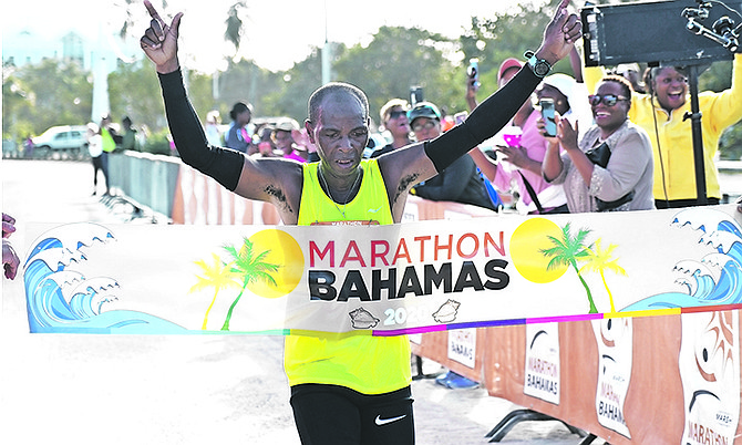 Delroy Boothe makes history as he crosses the finish line. Photo: Terrel W Carey/Tribune staff