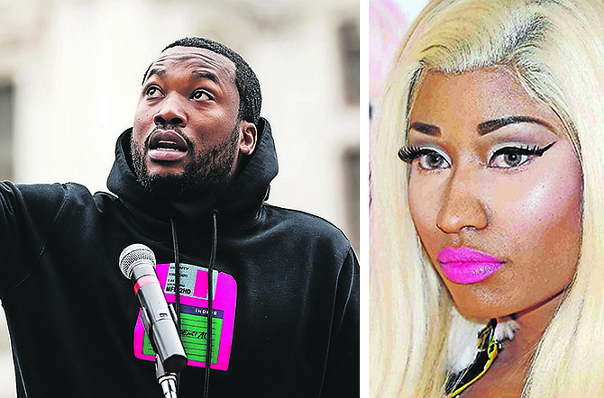 Meek Mill says he's been traumatised by wigs, but his ex, superstar rapper Nicki Minaj, is clearly a fan of the lace front. (AP Photos)