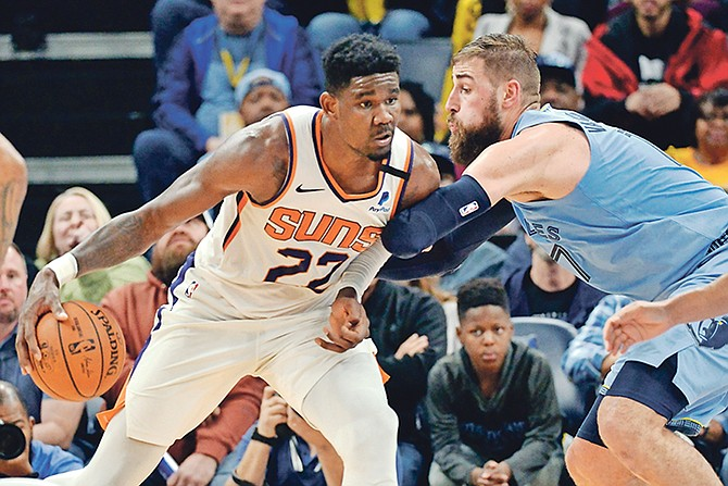 Phoenix Suns centre Deandre Ayton (22) handles the ball against Memphis Grizzlies centre Jonas Valanciunas (17) in the first half last night.