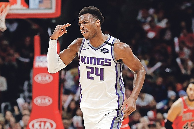 Sacramento Kings guard Buddy Hield reacts after making a three-point basket during the second half against the Bulls.
