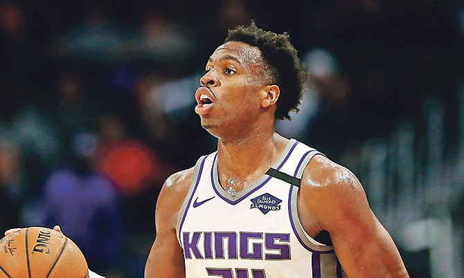 Sacramento Kings guard Buddy Hield brings the ball up court during the second half of Wednesday's game in Detroit.