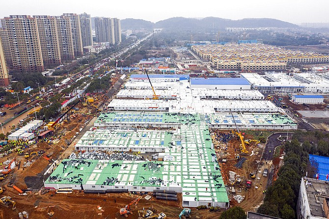 The Huoshenshan temporary field hospital under construction is seen as it nears completion in Wuhan in central China's Hubei Province, Sunday. (AP)