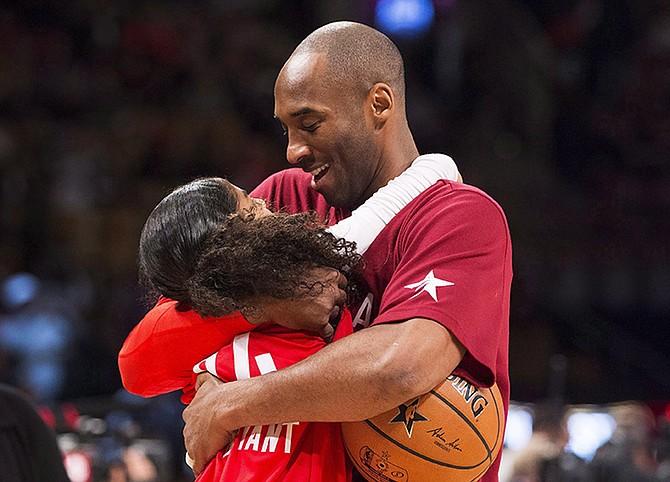 Kobe Bryant hugs his daughter Gianna in 2016. (Mark Blinch/The Canadian Press via AP)