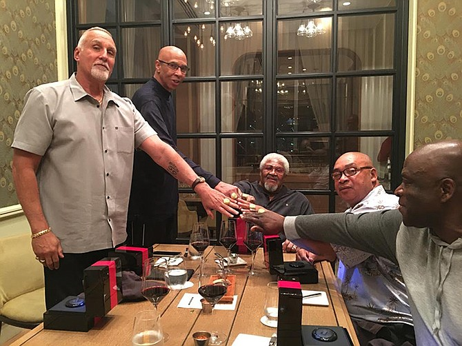 Jackson Five reunited (l-r) Roberto Gonzalez, Mychal Thompson, Coach Jake Caldwell, Osborne Lockhart and Charles Thompson all with their reunion rings.