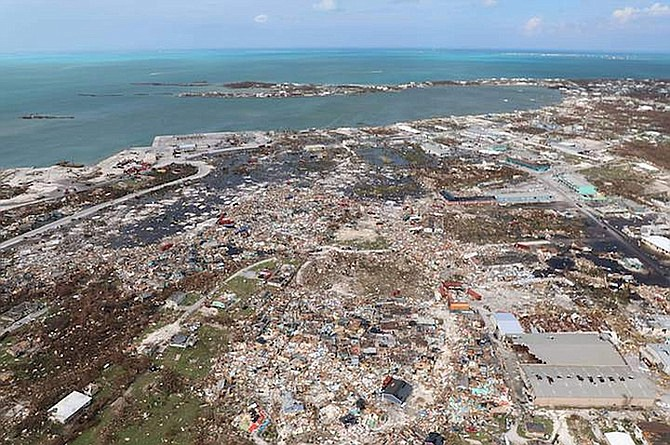 """The destruction caused by Hurricane Dorian is seen from the air, in Marsh Harbour, Abaco in September last year. Bahamas First chief executive Patrick Ward said laws making it mandatory for all business and residential property owners to have full catastrophic insurance cover """"must be on the table for discussion"""". (AP Photo/Gonzalo Gaudenzi)"""