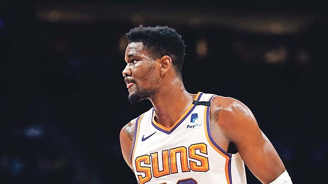 Suns centre Deandre Ayton in action during the first half of a game on February 5 in Detroit. A nagging ankle injury will keep him sidelined during NBA All-Star weekend.
