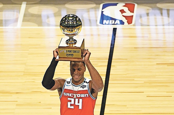 Sacramento Kings' Buddy Hield holds the trophy after winning the NBA basketball All-Star 3-point contest Saturday in Chicago.  (AP Photo/David Banks)