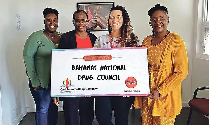 Gabriella Suighi, CBC communications marketing manager, with Bahamas Drug Council representatives.