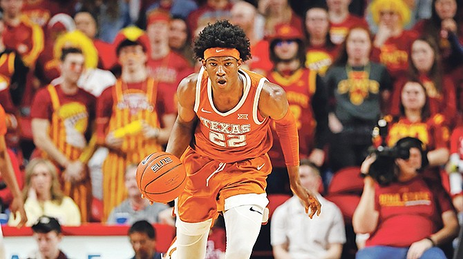 Texas forward Kai Jones drives up court during the second half of an NCAA college basketball game against Iowa State, Saturday, Feb. 15, 2020, in Ames, Iowa.  (AP Photo/Charlie Neibergall)