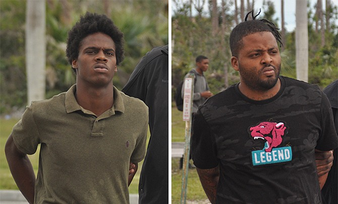 Tyreke Mallory, 21, (left) and Ricardo Jones, 27, are escorted to court on Friday to face murder and abetment to commit murder charges. Photos: Vandyke Hepburn