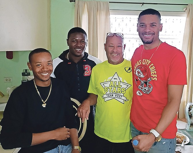 NFL Super Bowl champion Rashad Fenton (second left) poses with Cory, Chester and Jory Fox during a visit to Nassau on a cruise ship.