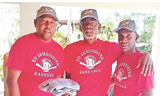 Sponsor Ivan 'Showtime' Francis shares a moment with patron Ed Armbrister and co-ordinator Michael Butler of the Ed Armbrister Baseball League.