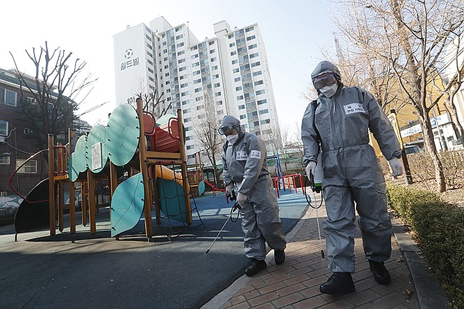 South Korean army soldiers spray disinfectant as a precaution against the coronavirus at a park in Seoul, South Korea, Thursday. The Ministry of Foreign Affairs has implemented new border control and quarantine measures for people travelling to the Bahamas from Italy, South Korea and Iran.