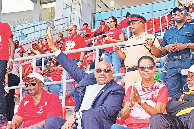 Prime Minister, Dr Hubert Minnis, waves during the Bahamas Association of Independent Secondary Schools (BAISS) annual track and field championships at the Thomas A Robinson Stadium yesterday.  Photos: Yontalay Bowe/BIS