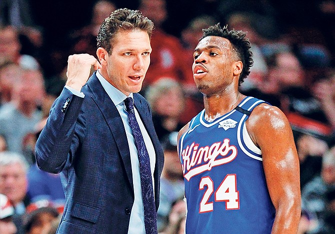 Sacramento Kings coach Luke Walton talks with guard Buddy Hield during the second half against the Portland Trail Blazers on Saturday, March 7. Sacramento won 123-111. Hield sat the entire fourth quarter of the Kings' 118-113 loss to the Toronto Raptors on Sunday night, prompting criticism of Kings head coach Luke Walton on his management of the rotation.