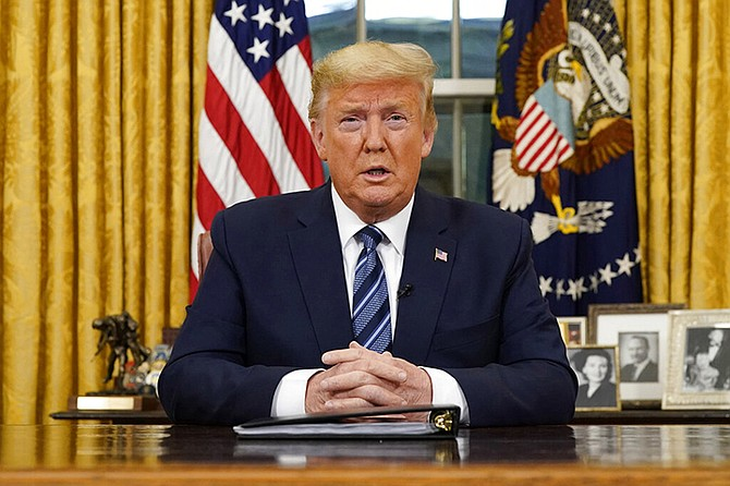 President Donald Trump speaks in an address to the nation from the Oval Office at the White House about the coronavirus Wednesday, in Washington. (Doug Mills/The New York Times via AP, Pool)