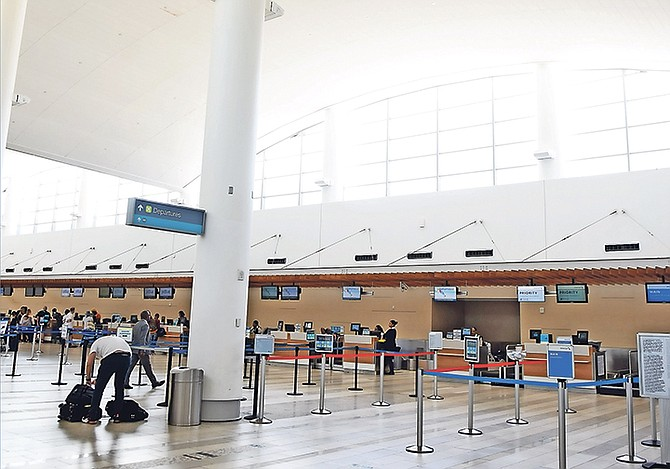The US departures area at Lynden Pindling International Airport looked pretty deserted yesterday.                                                                                              Photo: Shawn Hanna/Tribune Staff