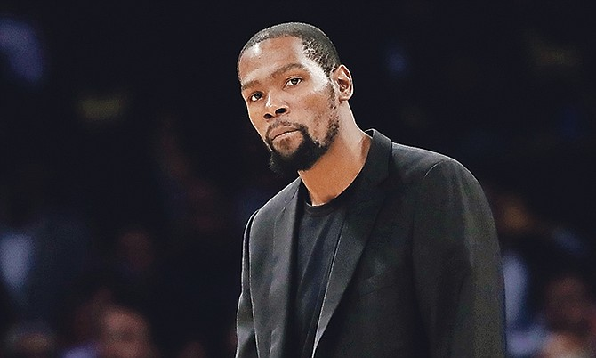 Brooklyn Nets' Kevin Durant looks on during the second half of an NBA basketball game against the Los Angeles Lakers Tuesday, March 10, 2020, in Los Angeles. (AP Photo/Marcio Jose Sanchez)