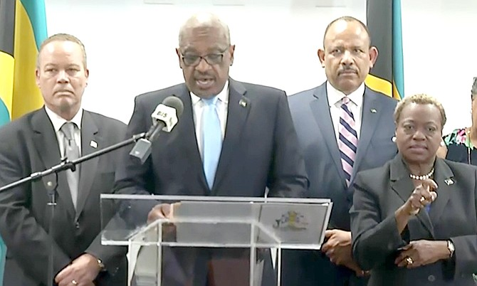 Prime Minister Dr Hubert Minnis speaks to the media.