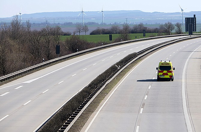 An emergency and rescue car drives on the deserted A4 highway near Erfurt, Germany, Monday.