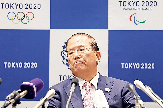 """Tokyo 2020 Organising Committee CEO Toshiro Muto attends a news conference yesterday after a Tokyo 2020 Executive Board Meeting in Tokyo. Tokyo Olympic President Yoshiro Mori said yesterday he expects to talk with IOC President Thomas Bach this week about potential dates and other details for the rescheduled games next year. Both Mori and Muto said the the cost of rescheduling will be """"massive"""" - local reports suggest several billion dollars - with most of the expenses borne by Japanese taxpayers.  (Issei Kato/Pool Photo via AP)"""