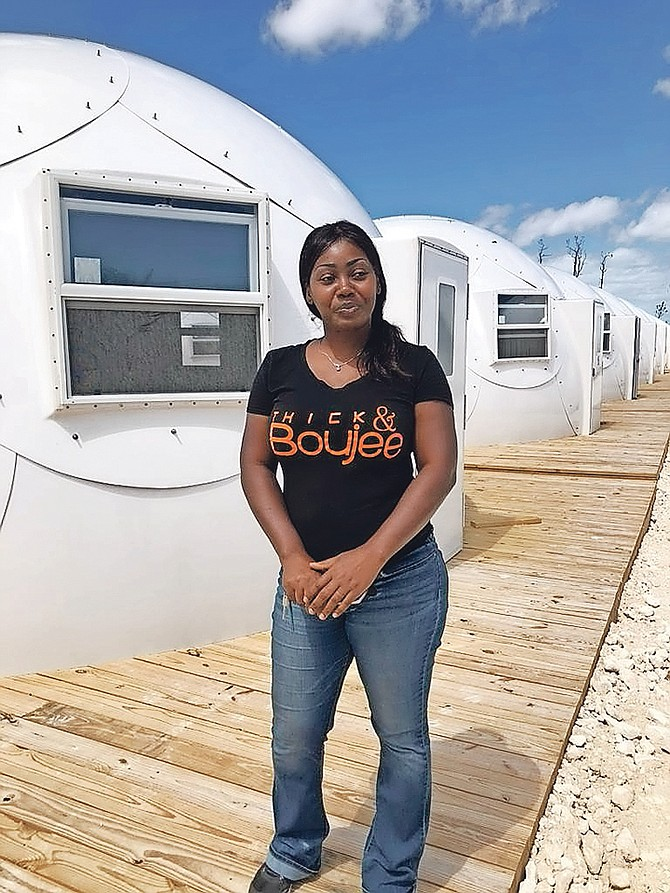Before entering her new temporary housing dome, Abaco resident Natalie Hepburn McCardy stands in front of a row of new domes erected for 32 families in Spring City, Abaco. (Disaster Reconstruction Authority)