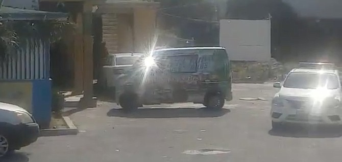 A police car outside a liquor store in an image taken from a video circulating on social media