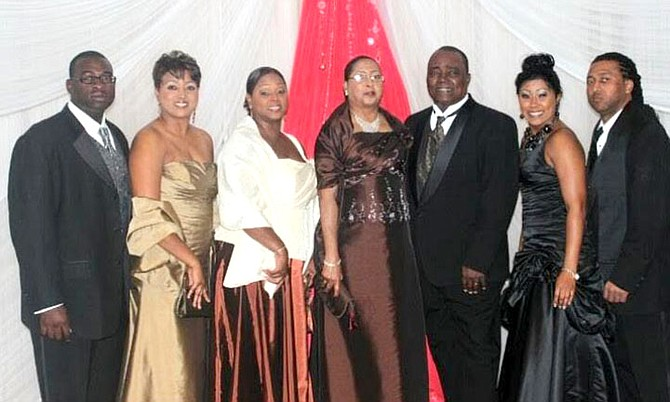 Rev and Mrs Moss, centre, with children (left to right) D'Angelo, Carla, Carolyn, Crystal and Carlton.