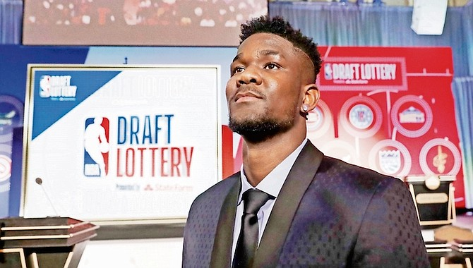 Arizona's Deandre Ayton poses for a portrait before the NBA basketball draft lottery on Tuesday, May 15, 2018, in Chicago. He was the No.1 pick, selected by the Phoenix Suns.  (AP Photo/Charles Rex Arbogast)