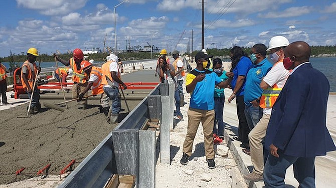 MINISTER of State for Disaster Preparedness, Management and Reconstruction Iram Lewis (left) explains to Deputy Prime Minister Peter Turnquest, and Minister of State for Grand Bahama, Kwasi Thompson some of the work being carried on Fishing Hole Bridge. Photo: Lisa Davis/BIS
