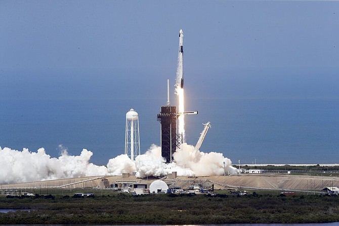 The SpaceX Falcon 9, with NASA astronauts Doug Hurley and Bob Behnken in the Dragon crew capsule, prepares to lift off from Pad 39-A at the Kennedy Space Center in Cape Canaveral, Fla., Saturday. (AP Photo/Chris O'Meara)