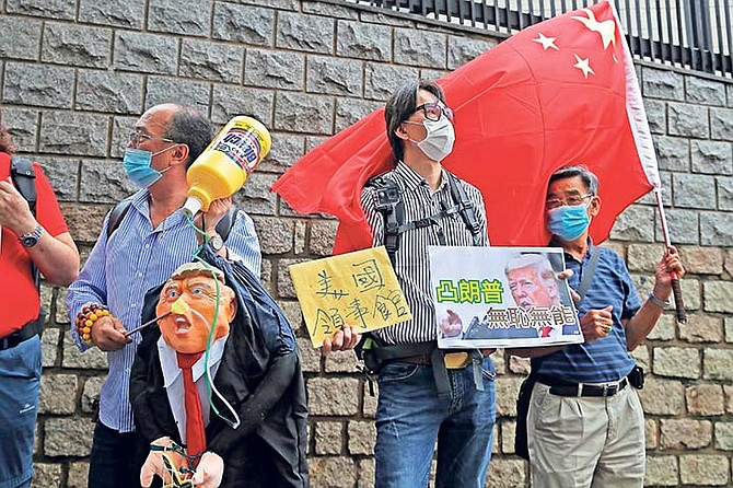 Pro-China supporters hold the effigy of U.S. President Donald Trump and Chinese national flag outside the US Consulate during a protest, in Hong Kong at the weekend. (AP)