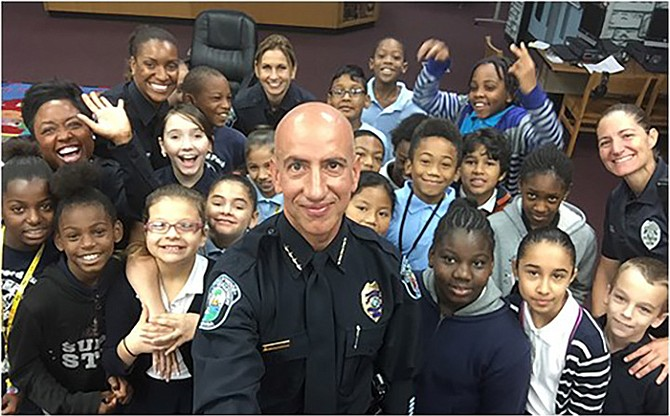 Hollywood officers serve as mentors to at-risk students and the department has established its Cops Mentoring Kids programme. Above, former police chief Sanchez.