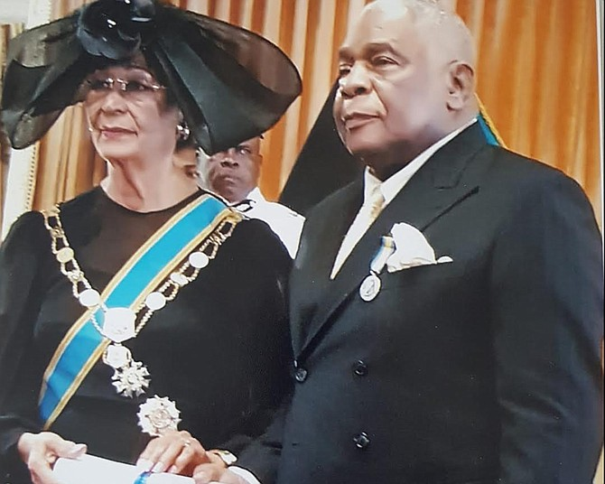 DR Patrick Roberts receiving his National Honour of Distinction from the-then Governor General, Dame Marguerite Pindling. Current GG CA Smith called him a true Bahamian patriot.