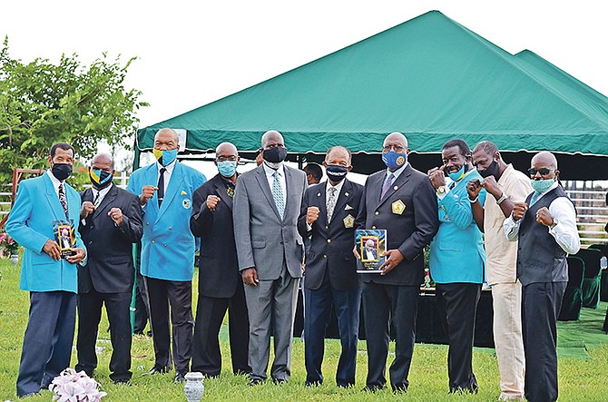 """PALLBEARERS pose above during the graveside service for Leonard """"Boston Blackie"""" Miller at Lakeview Cemetery. Photo: Athama Bowe"""