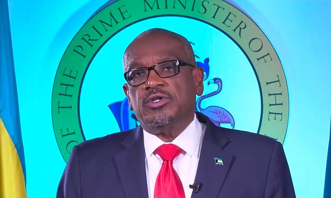 Prime Minister Dr Hubert Minnis delivers his address on Sunday.