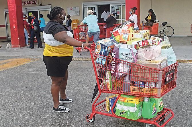 Grand Bahamians stock up on supplies before the island's lockdown. Photo: Vandyke Hepburn