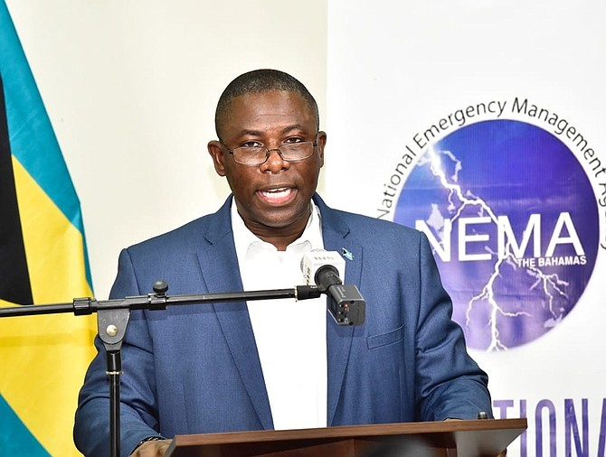 Minister of Health Renward Wells speaks on Friday.