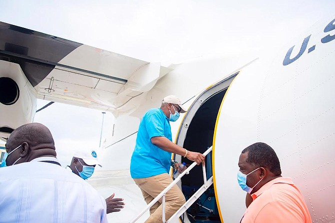 Prime Minister Dr. Hubert Minnis boarding U.S. Coast Guard HC-144 Ocean Sentry for an initial aerial overview to survey the damage and assess the needs of those in the immediate aftermath of Hurricane Isaias on Sunday. (PHOTO/OPM Communications Unit)