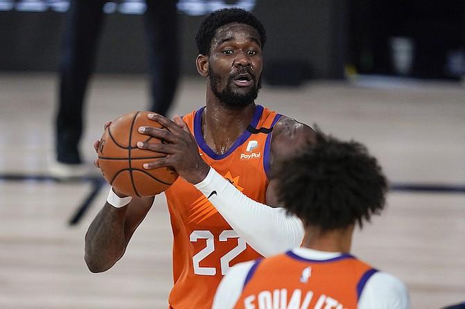 Phoenix Suns centre Deandre Ayton (22) looks to pass against the Dallas Mavericks during the second half on Sunday. (AP Photo/Ashley Landis, Pool)